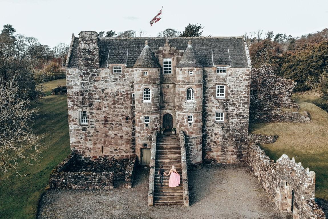 couple outside rowallan old castle in ayrshire