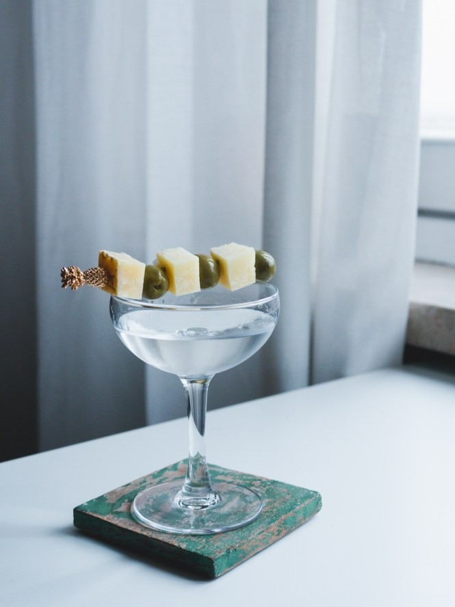 Martini with olives and cheese