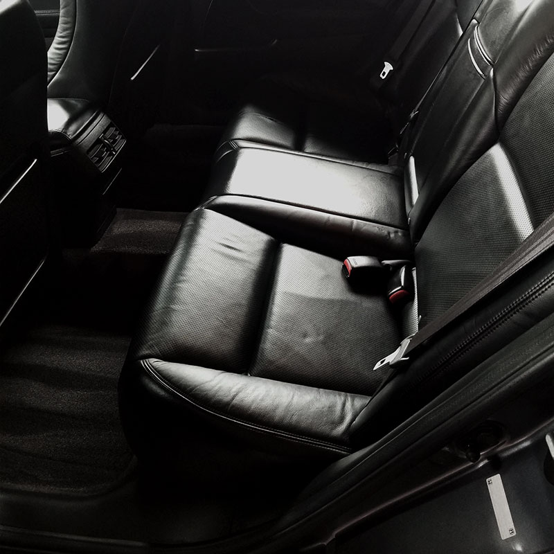 Clean back leather seats and floors shampooed.