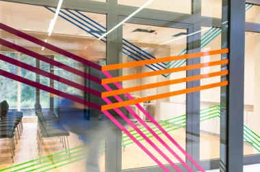 Esther HagenMaier (2015) Zusammenspiel, glass wall design in the foyer of the building sheet cut to two glass door elements