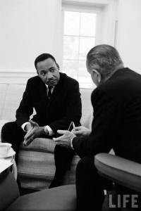 Dr. Martin Luther King Jr speaking with President Lyndon B. Johnson.