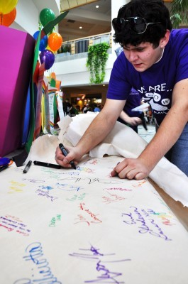 Co-President of the LGBTQA, Jordan Darosh, signs alliance pledge