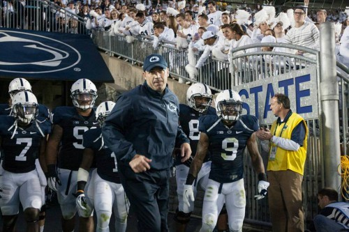 Bill O'Brien leading the team out of the tunnel against Central Florida