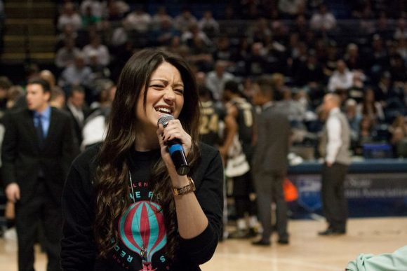 """The composers of """"Diamonds in the Air,"""" Brittany Hicks and Chris Carmody, performed their original song about THON during an early timeout at the basketball game."""