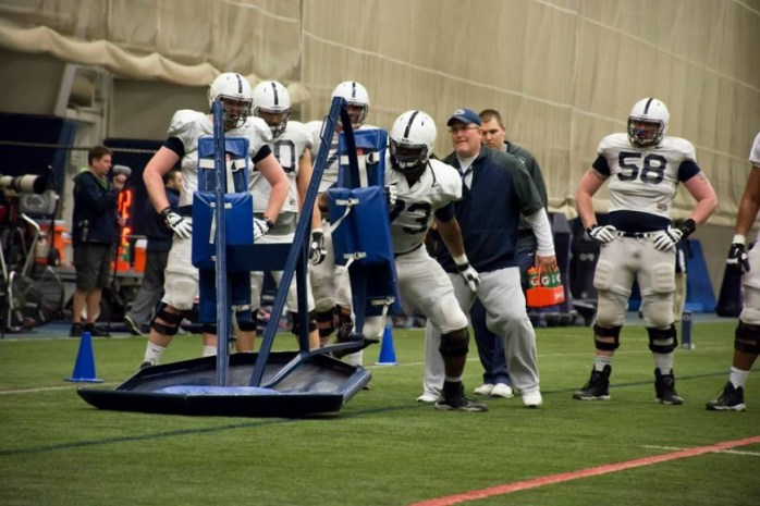 Paris Palmer (No. 73) pushes the sled at Penn State's practice. (Photo: Jack Lukow)