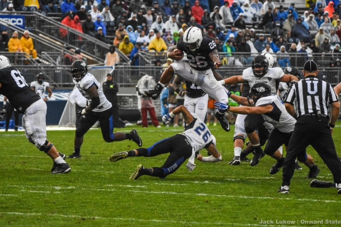 Saquon Barkley hurdles the Bull's safety early in the fourth quarter, leading to a three minute touchdown drive.