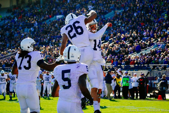 Saquon Barkley is mobbed in the endzone after scoring against Northwestern.