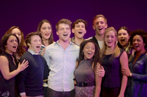 """Musical Theatre student Johnny Link sings """"Being Alive,"""" accompanied by other seniors."""