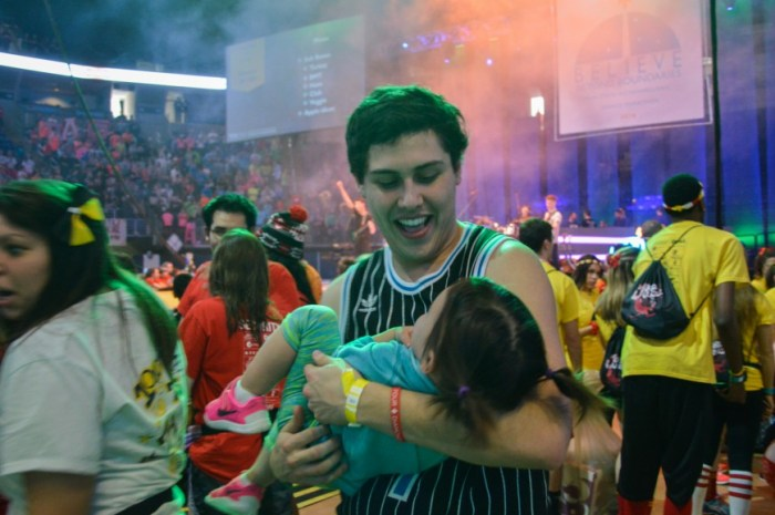 A dancer plays with a THON child during the mid day Saturday.