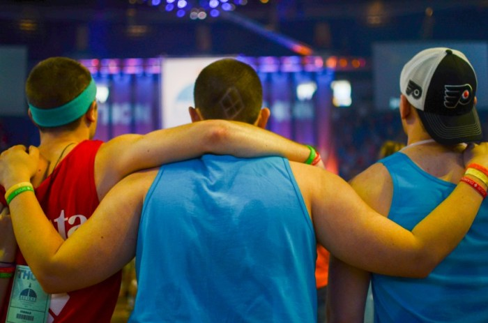 Three friends embrace during the Final Four hours.