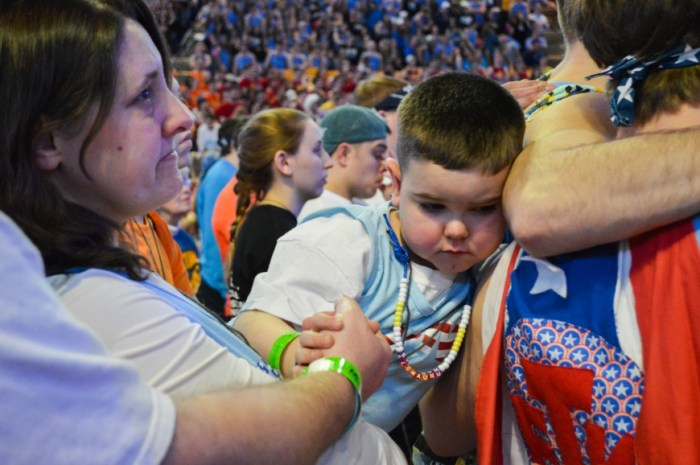 An emotional moment for a THON child during Family Hour.