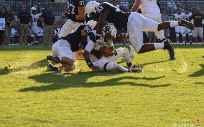 Garrett Sickels and Antoine White tackle a kent state football player fall 2016