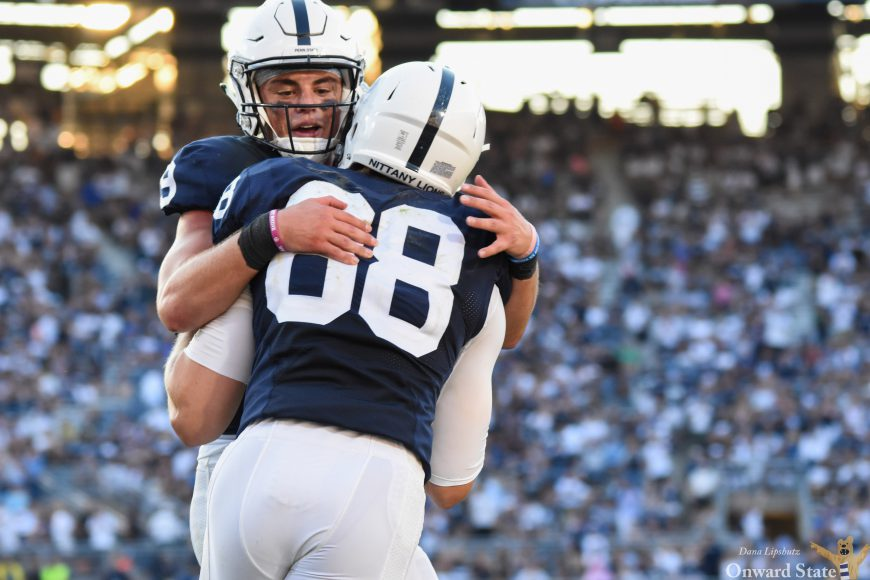 Mike Gesicki and Trace McSorely embrace after Gesicki scored for the second time that game.