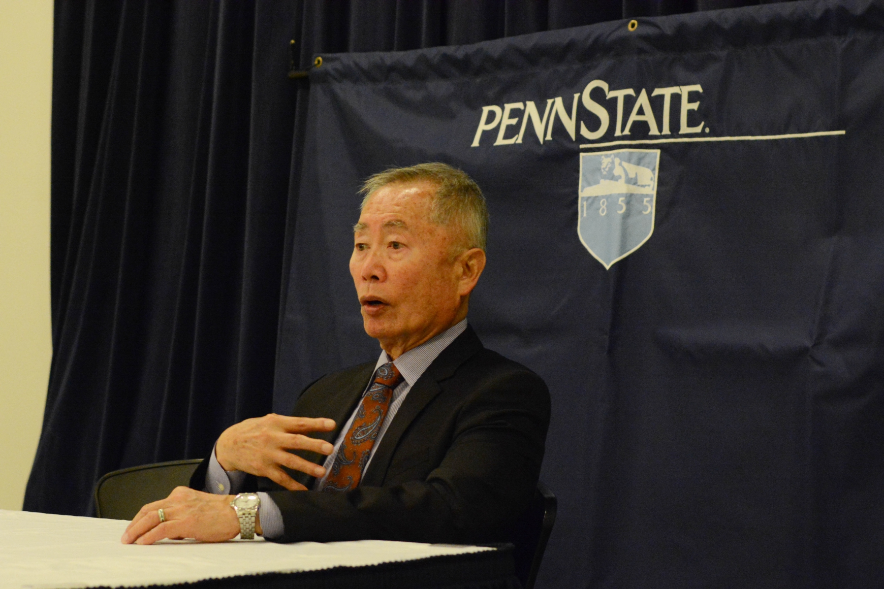 Takei speaks with members of the press before addressing the crowd in Eisenhower