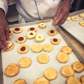 Chef was sandwiching the cookies together with raspberry jam. - created by On Yi