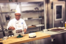 Chef is masking the cake.