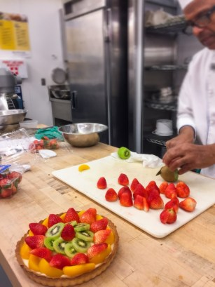 Chef is cutting the fruits.