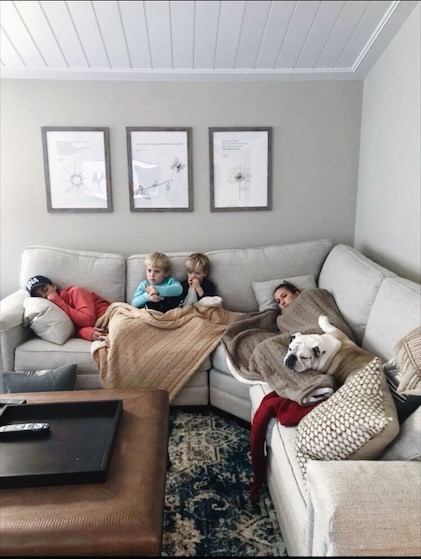gray scale living room with sectional couch and minimal wall art
