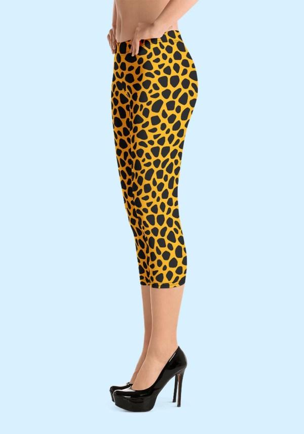 Woman wearing unique Leopard Zouk Capri Leggings designed by Ooh La La Zouk. Left side high heels view.