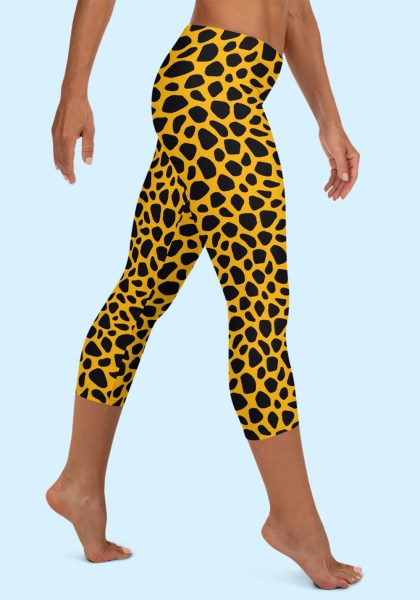 Woman wearing unique Leopard Zouk Capri Leggings designed by Ooh La La Zouk. Right side barefoot view (2).