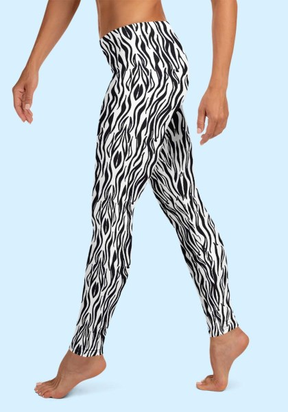 "Woman wearing Zouk Leggings decorated with a unique ""Animalistic Zouk"" design by Ooh La La Zouk. Left side view (2) barefoot."