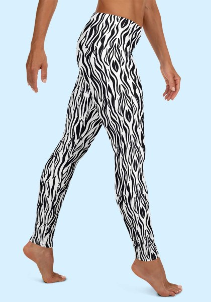"""Woman wearing Zouk Leggings decorated with a unique """"Animalistic Zouk"""" design by Ooh La La Zouk. Right side view (2) barefoot."""