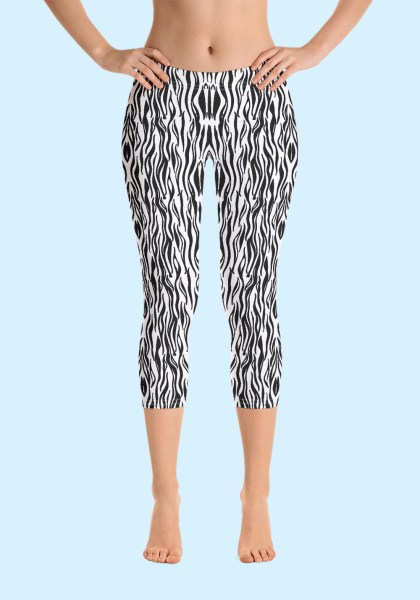 "Woman wearing Zouk Capri Leggings decorated with a unique ""Animalistic Zouk"" design by Ooh La La Zouk. Front view (1) barefoot."