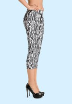 "Woman wearing Zouk Capri Leggings decorated with a unique ""Animalistic Zouk"" design by Ooh La La Zouk. Right view (3) high heels."