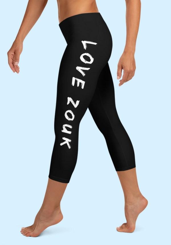 """Woman wearing Zouk Leggings decorated with unique """"Love Zouk"""" Capri design by Ooh La La Zouk. Left side, barefoot view."""