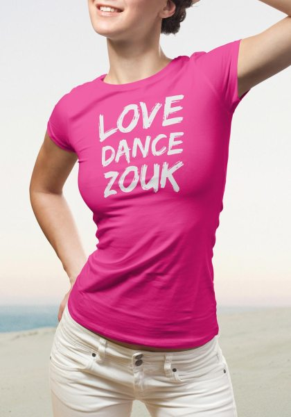 """Woman wearing Zouk T-shirt decorated with unique """"Love Dance Zouk"""" design in pink crew neck style"""