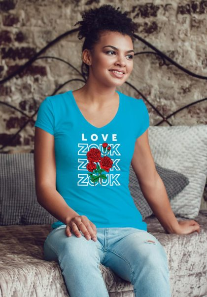 Woman wearing Zouk T-shirt decorated with unique Zouk Bouquet design (blue v-neck style)