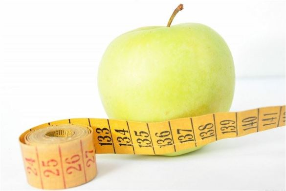 apple with tape measure