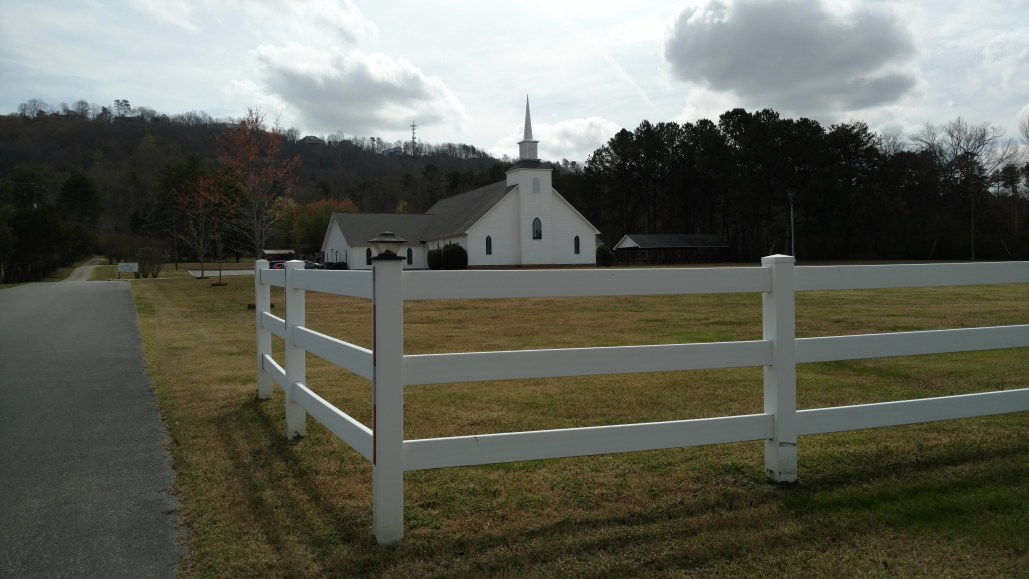 Ooltewah Church of Christ Building front with fence