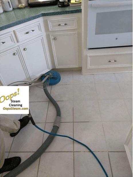 to clean grout between floor tiles