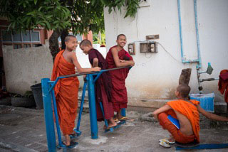 Some young Novice Monks exercising on the specially built exercise equipment which can be fund all around the monastery.