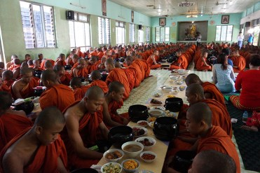 450 Monks and Novices eating lunch in the dining hall.