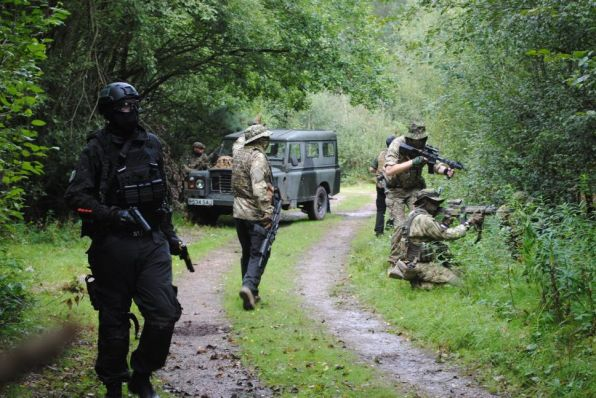 Airsofters advancing down a path