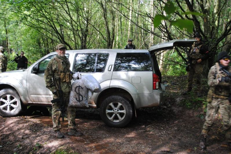 Airsofters around a car