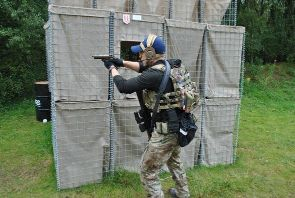 Airsoft player with pistol