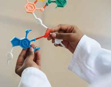 crop chemist holding in hands molecule model