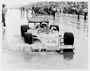 Bobby Unser rolls down the flooded Indianapolis Motor Speedway pit lane.