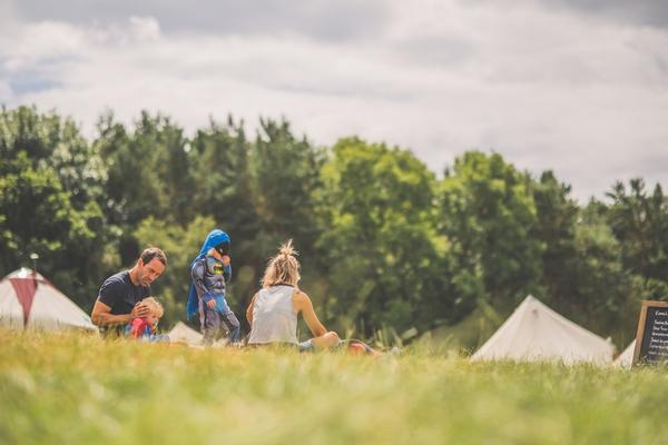 People sat in a field in Kelmarsh