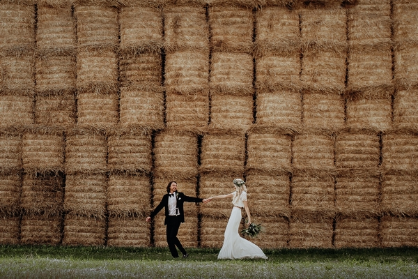Houchins couple infront of hay bales