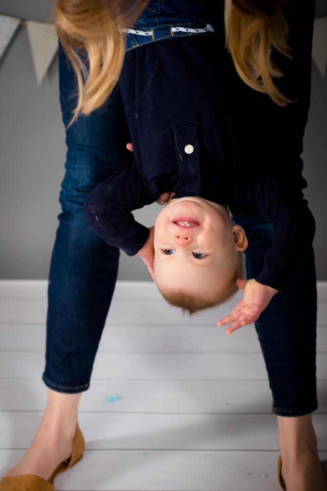 Birthday boy upside down with mom