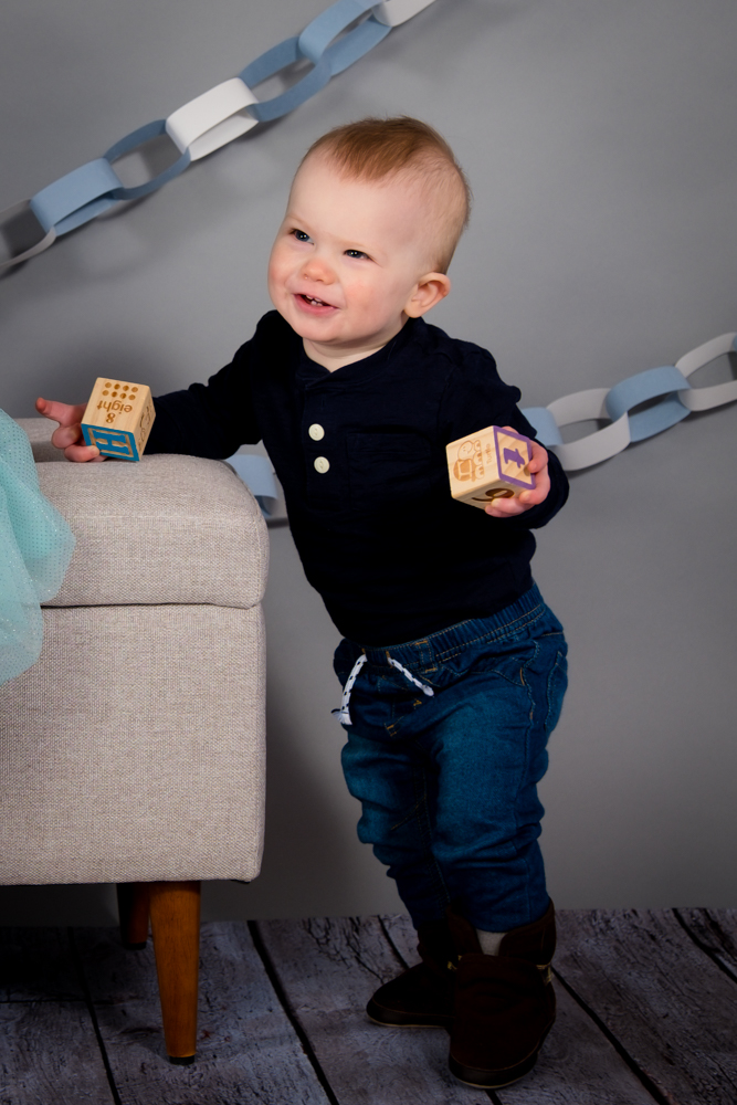Little boy smiling holding blocks