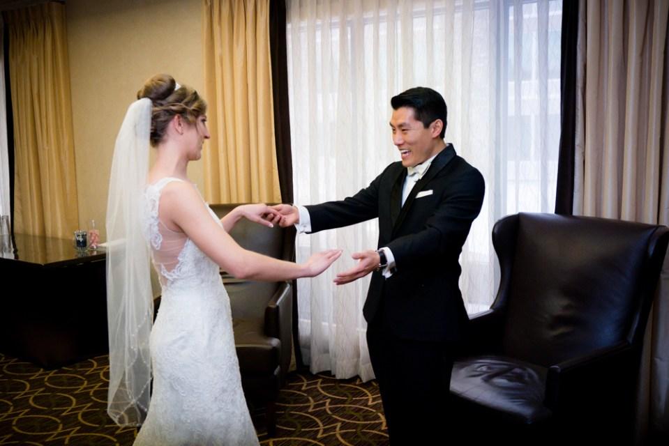 Groom admiring bride's dress
