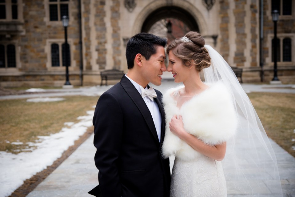 Bride and groom forehead to forehead in Ann Arbor Law Quad
