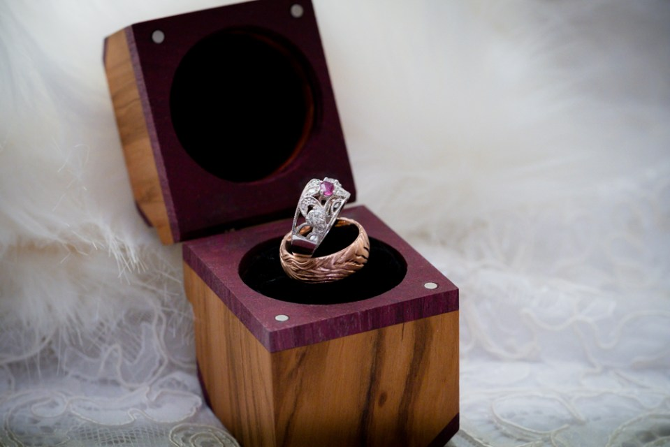 Open handmade ring box and wedding rings