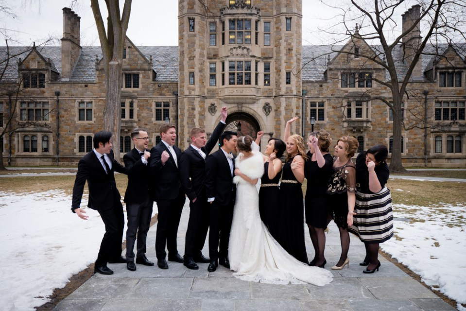 Full bridal party and team cheering in the Ann Arbor Law Quad