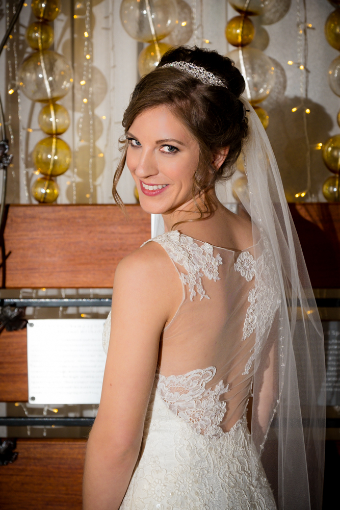 Bride in her stunning dress at Vinology
